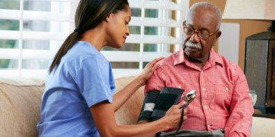 nurse checking a senior man's blood pressure