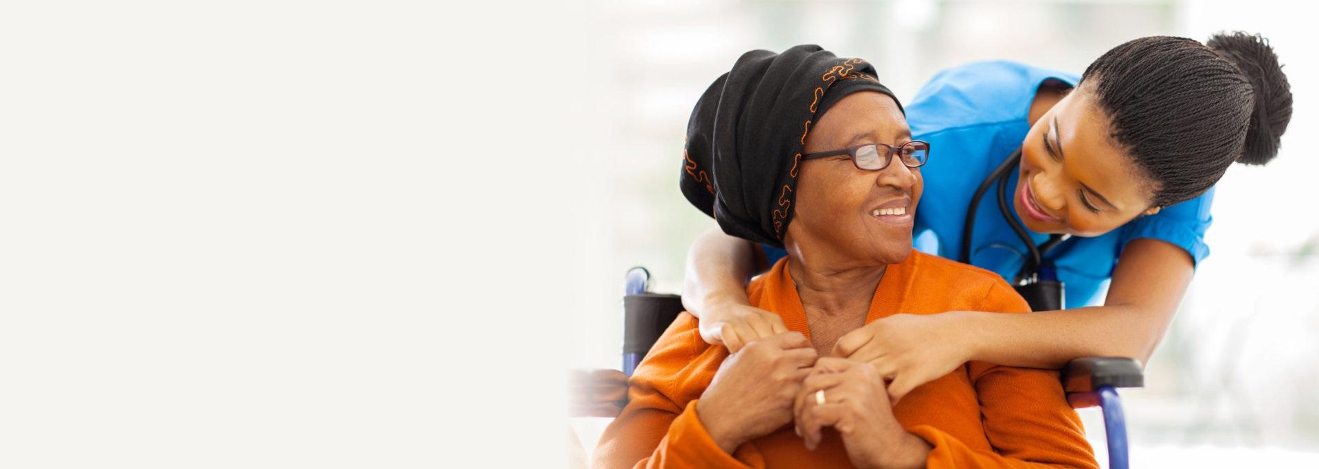 nurse hugging her senior patient